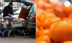 Mandarinai pirkėjų krepšiuose