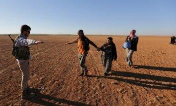Sirijos sukilėlis ir nuo Islamo valstybės pabėgę žmonės