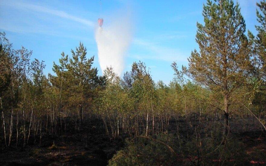 Горящий лес тушили и военные вертолеты