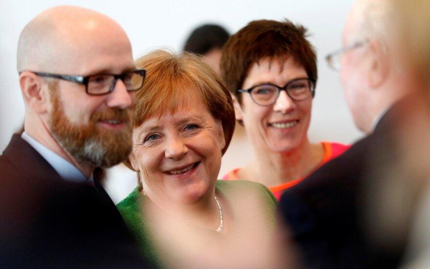 Peteris Tauberis, Angela Merkel, Annegret Kramp-Karrenbauer