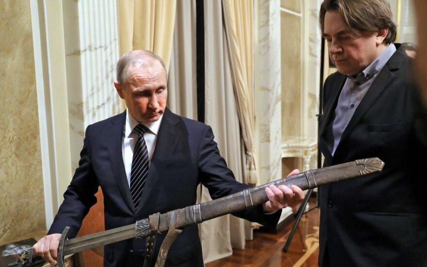 https://g2.dcdn.lt//images/pix/880x550/W1YPlAL0m6g/rusijos-prezidentas-vladimiras-putinas-per-susitikima-su-filmo-vikinga-73519788.jpg