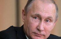 V. Putinas įvertino JAV prezidentui metamus skandalingus kaltinimus