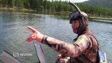 Владимир Путин поймал щуку во время подводной охоты в Сибири