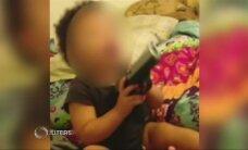 Indianoje sulaikyta porelė, nufilmavusi kūdikį su pistoletu rankoje