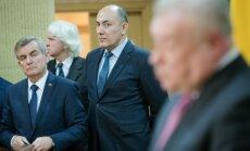 Seimas Speaker Viktoras Pranckietis and advisor Kęstutis Kudzmanas listening to the Russian Ambassador