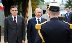 Francois Fillonas ir Vladimiras Putinas