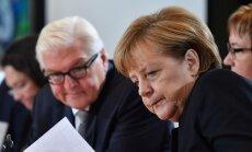 Frankas Walteris Steinmeieris  ir Angela Merkel