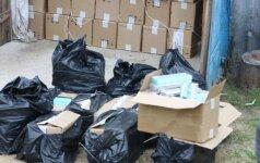 Šalčininkų rajone pasieniečiai aptiko didelį kontrabandinių cigarečių sandėlį