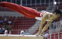 Kanados gimnastas Kennethas Ikeda