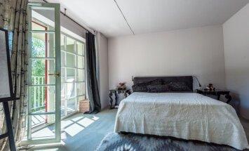 115 kv.m butas Vilniuje: klasikos ir gamtos harmonijos derinys