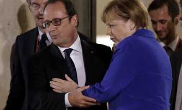 A. Merkel, F. Hollande'as