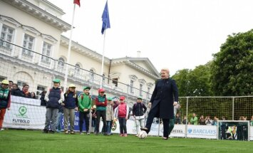 President Grybauskaitė plays football in the front of the Presidential palace in Vilnius.  July 2 2017
