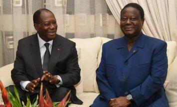 Alassane'as Ouattara (kairėje)