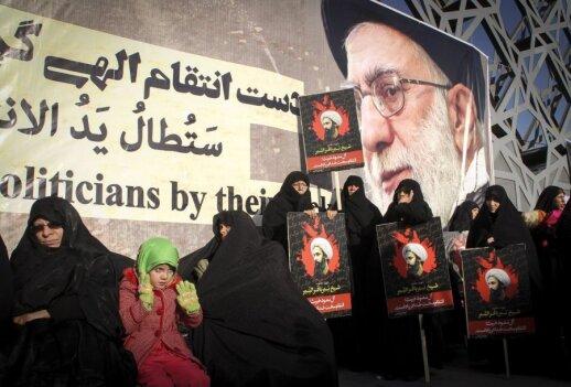 Šiitai Teherane (Iranas) demonstracijoje prieš Saudo Arabiją ir šiitų dvasininkui Nimra al Nimrui įvykdytą egzekuciją