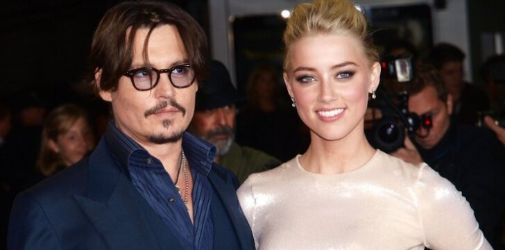 Johnny Deppas ir Amber Heard.