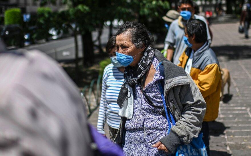 JAV panaikino perspėjimą nekeliauti į užsienį, bet sugriežtino perspėjimą dėl Meksikos