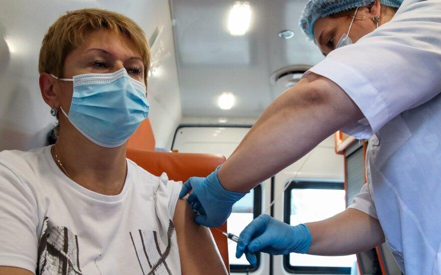 Putino vakcinos triukas kelia pavojų visam pasauliui