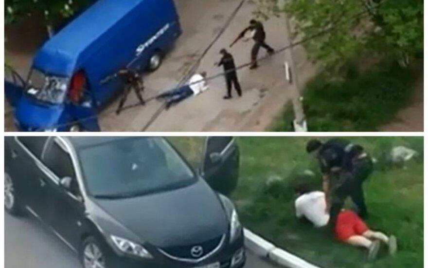 Vaizdo įrašai: kaukėti užpuolikai Luhanske šiurpina gyventojus