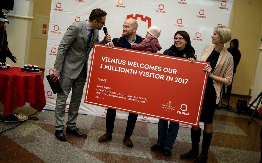 Vilniaus milijonasis turistas Christianas Veske su šeima