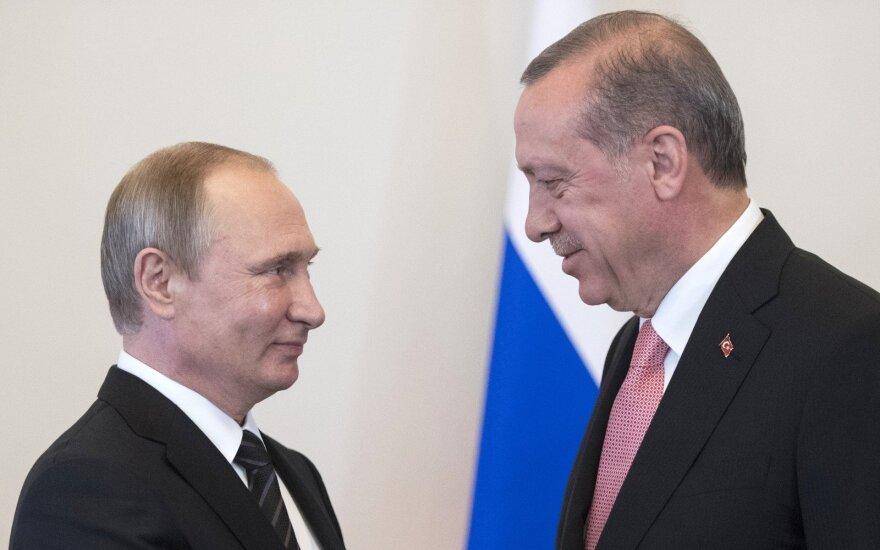 Turkijos prezidentas ėmėsi grasinimų bankams