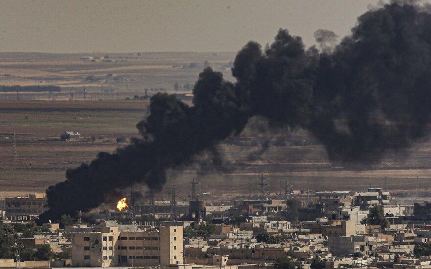 Bombarduojamas Ras al Aino miestelis