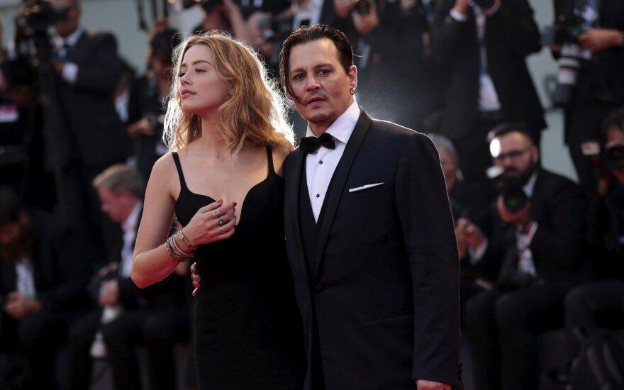 Aktorius Johny Deppas ir jo žmona Venecijos kino festivalyje