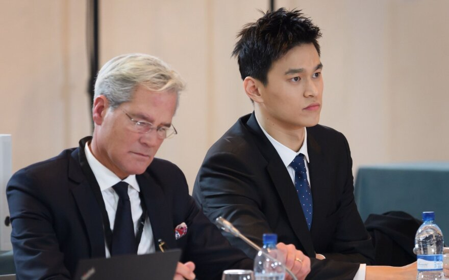 Sun Yangas su savo advokatu Ianu Meakingu