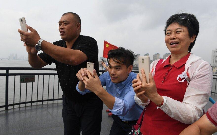 Ekskursijos į Šiaurės Korėjos pasienį: kinai keliauja stebėti skurstančių kaimynų