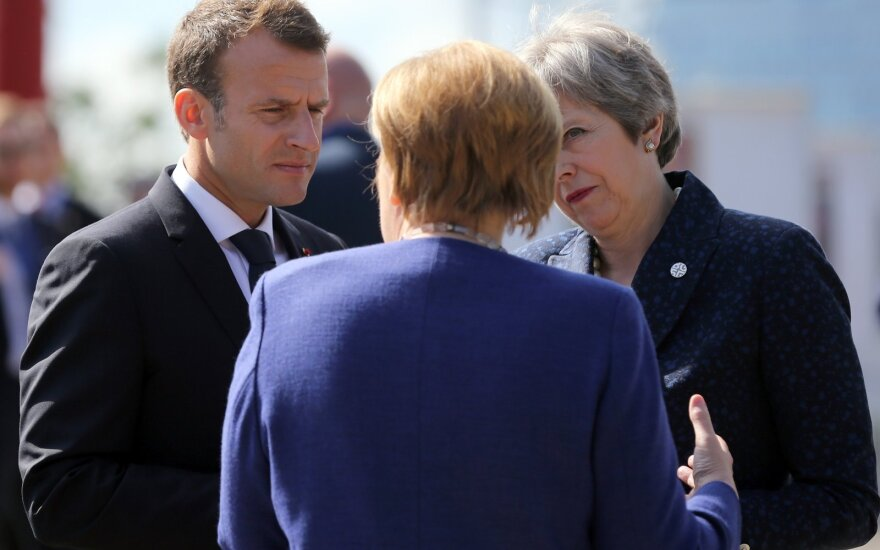 Emmanuelis Macronas, Angela Merkel, Theresa May