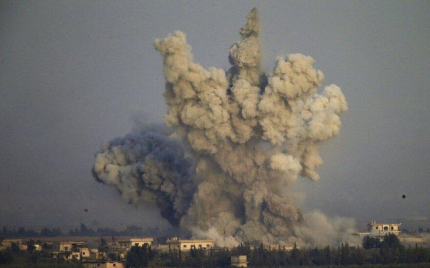 """Irako pajėgos per antskrydžius Sirijoje nukovė 28 """"Islamo valstybės"""" teroristus"""