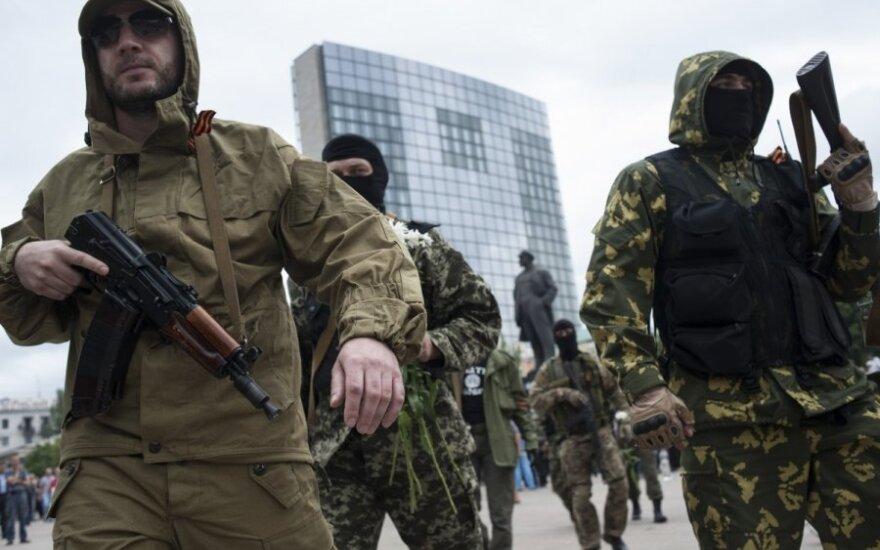 Pasaulis džiaugiasi dėl Minske pasirašytų paliaubų, tačiau vertina jas atsargiai
