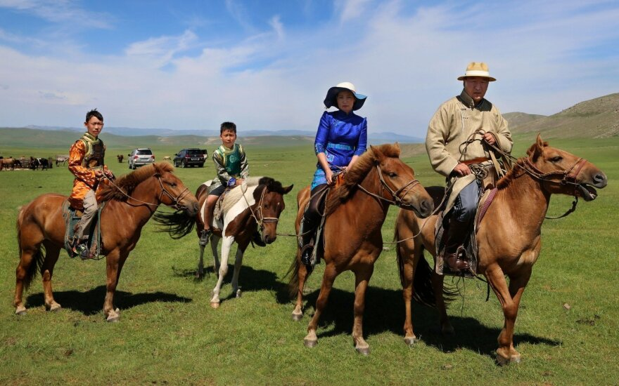 Sanjsuren Boldbaatar horseback riding with his family