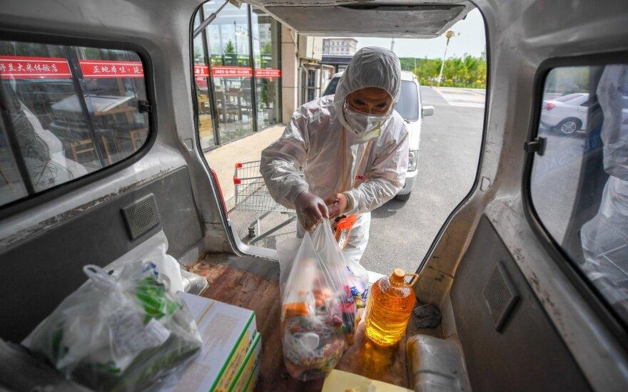 Kinijos gydytojai: naujo protrūkio pacientams virusas pasireiškia kitaip