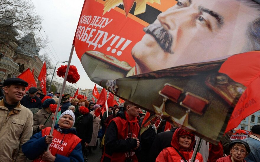 Images of Joseph Stalin at a rally