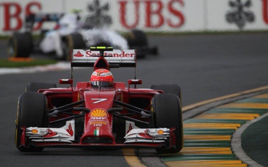 """Kimi Raikkonenas su """"Ferrari F14-T"""" automobiliu"""