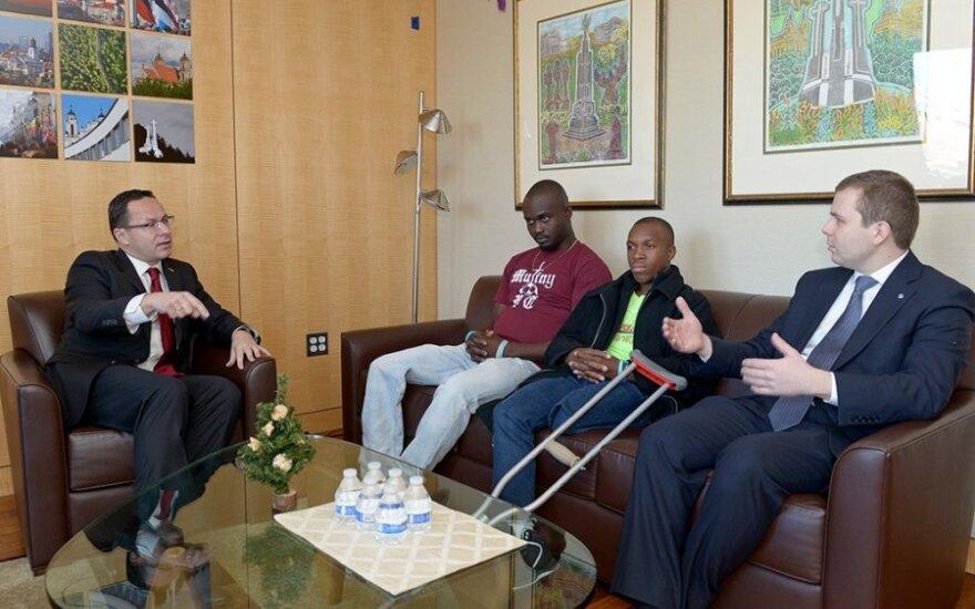 FLTR Ambassador Pavilionis, Mackenson Pierre, Sandy Louiseme and Szymon Czyszek of the Knights  Photo Ludo Segers