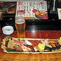 Sushi rinkinys ir šaltas alus