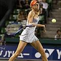 Rusijos tenisininkė Marija Šarapova smūgiuoja kamuoliuką