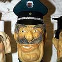 Butelis su policininko atvaizdu